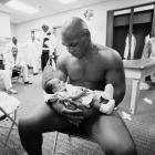 Tyson holds two-month-old son Miguel in his dressing room after losing to Lennox Lewis by knockout in the 8th round of their title fight on June 8, 2002 at the Pyramid Arena in Memphis, Tenn.