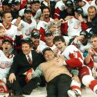 Scotty Bowman (bottom, center) relaxed with his merry boys and owner team Mike Ilitch in Detroit after they beat the Carolina Hurricanes to secure the ninth, and final, Stanley Cup of the legendary coach's 30-year NHL career. He retired after the game.