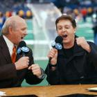 """Bradshaw and Paul McCartney sing a duet of """"A Hard Day's Night"""" during Super Bowl XXXVI at the Superdome in New Orleans."""