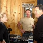 Mena Suvari talks with Brian Bosworth and Peter Koral at The Seven for All Mankind Lodge in Park City, Utah.
