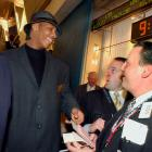 Carmelo Anthony of the national champion Syracuse Orangemen signs autographs as he tours the New York Stock Exchange trading floor. Melo and his coach, Jim Boeheim, rang the exchange opening bell.