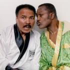"""Fierce rivals in the ring, Ali and Joe Frazier pose for a portrait in the boxing robes they wore the night of their first bout at Frazier's Gym in 2003. Ali said after Frazier's death in 2011 that he was """"a great champion."""""""