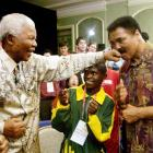 Mandela lands a playful punch on the chin of former world champion boxer Muhammad Ali. The two were in Dublin to attend the 2003 Special Olympics World Summer Games.