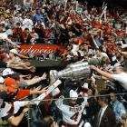 New Jersey Devils captain Scott Stevens carries the Stanley Cup off the ice after beating the Mighty Ducks of Anaheim 3-0 in Game 7 in East Rutherford, N.J.