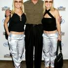 Bradshaw poses with the Coors Light Girls at the grand opening of the Fox Sports Grill at the Irvine Spectrum on June 26, 2003 in Irvine, Calif.