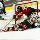 Ducks winger Paul Kariya found himself sandwiched under Devils defenseman Scott Niedermayer and goalie Martin Brodeur during Game 6 in Anaheim. Kariya had a rough outing in that one, but a scored a goal as his Ducks staved off elimination in the series for one more game.