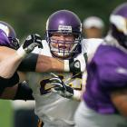 Pro wrestler Brock Lesnar fights through the offensive line in a morning drill during Vikings training camp in Mankato, Minn.  Lesnar played during the preseason for Minnesota, but ended up being a late cut.