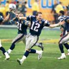 Tom Brady and the New England Patriots rush the field after defeating the Carolina Panthers. Kicker Adam Vinatieri nailed a 41-yard field goal with four seconds remaining to put the Patriots on top 32-29.