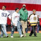 New England Patriots stars Richard Seymour and Tedy Bruschi walk to the mound alongside Bill Russell and Bobby Orr to toss the first pitch before the Red Sox home opener against the Yankees in 2005. After the Red Sox banished the Curse of the Bambino the previous fall, the team brought in some of Boston's biggest champions for the ceremony.