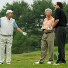 George H.W. Bush and Bill Clinton, joined by CBS sportscaster Jim Nantz, play golf in 2005 at the Cape Arundel Golf Club in Kennebunkport, Maine.