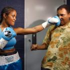 Ali takes a punch from his daughter Laila Ali while sparring before her fight against Erin Toughill in 2005. Laila retired from her own successful boxing career with a professional record of 24-0.