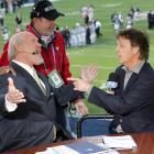 Bradshaw jokes around with Paul McCartney during the Super Bowl XXXIX pregame show at Alltel Stadium in Jacksonville.