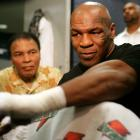 Muhammad Ali sits with Mike Tyson as he gets his hand wrapped before his fight with Kevin McBride in Washington, D.C.