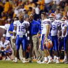 Tim Tebow and Chris Leak look on during a game against Tennessee. The quarterbacks would split time during Tebow's freshman year and go on to win a BCS national title.