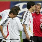 Klinsmann with members of the German national team, including captain Michael Ballack (center), during World Cup training in 2006.
