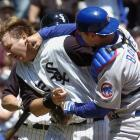"""Cubs catcher Michael Barrett didn't take too kindly to being run over at the plate by his counterpart, White Sox catcher A.J. Pierzynski. After Pierzynski slapped home plate and got up, Barrett grabbed him and puched him in the jaw. """"He grabbed me and said, 'I didn't have the ball' and then he punched me,"""" Pierzynski said. """"I was trying to pick up my helmet."""""""