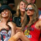 Coleen McLoughlin, girlfriend of England's Wayne Rooney, sits behind Cheryl Tweedie, girlfriend of England's Ashley Cole, and Victoria Beckham, wife of England's David Beckham, as they look on from the stands before the beginning of England's Group B clash with Trinidad and Tobago in the 2006 World Cup.