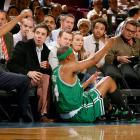Paul Pierce falls on the floor near Jimmy Fallon, Wayne Rooney and his girlfriend Coleen McLoughlin during the Boston Celtics game against the New York Knicks at Madison Square Garden on Dec. 11, 2006 in New York City.