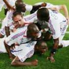 France's Patrick Vieira is mobbed by his teammates after scoring his team's second goal during France's Round of 16 match against Spain in the 2006 World Cup.