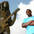 Bolt, next to a statue of fellow countryman and legendary reggae singer Bob Marley, was born in Trelawny, Jamaica, on Aug. 21, 1986.