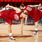 Teammates Taylor and Blake Griffin get loose before an Oklahoma practice.