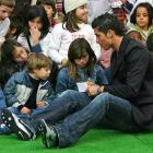 After giving Christmas gifts to a group of underprivileged children, Cristiano Ronaldo takes time to sign autographs.