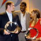 2006 Gatorade Male Athlete of the Year Greg Oden congratulates the 2007 Gatorade Athletes of the Year, Kevin Love and Maya Moore, in Los Angeles.