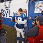 Peyton and Archie Manning hug in the moments after the Colts dramatic comeback victory over the rival New England Patriots in the 2007 AFC Championship Game.