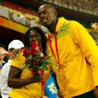 Bolt poses with his mom after winning the gold medal in the men's 100m final with a world record time of 9.69 during the 2008 Summer Olympics in Beijing, China.