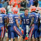 Tim Tebow attempts to motivate his team during their Capitol One Bowl game. Florida lost 41-35 to Michigan.
