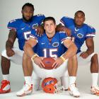Tim Tebow poses with teammates Brandon Spikes and Percy Harvin during an SI college football preview photo shoot. All three were later drafted by NFL teams.