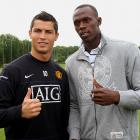 Bolt poses with Manchester United star Cristiano Ronaldo ahead of a First Team training session at Carrington Training Ground in Manchester, England. Ronaldo left United to join Spanish side Real Madrid later in 2009.