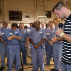 Tim Tebow prays with inmates at Lawtey Correctional Institution. Tebow and former NFL head coach Tony Dungy often share their faith in America's prisons.