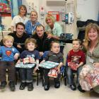 Owen and Rooney of Manchester United pose with Isaac Eaton, Archie Eaton, Jacob Cohen and Szymon Cohen at the Royal Manchester Children's Hospital as part of the club's annual hospital visits on Dec. 23, 2009 in Manchester, England.
