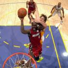 In his first trip to Staples Center as a member of the Heat, LeBron James led his new team to a 96-80 thrashing of the two-time defending champions on Christmas Day. The King notched his third triple-double with Miami and the 31st of his career (27 points, 11, rebounds and 10 assists) while hitting a season-high five three-pointers. Kobe Bryant, meanwhile, was held to just 17 points L.A.'s loss.