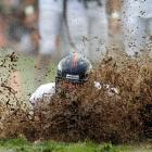 Broncos guard Zane Beadles dives into the mud as rookies partake in the slip and slide fumble drill during training camp at Dove Valley in Englewood, Colo.