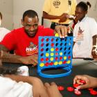 Regardless of the ill will, James still makes time for his fans. In this photo, The King plays Connect Four with children from the Miami Rescue Mission.