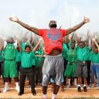 """LeBron joins 200 youth in a spontaneous """"chalk clap"""" to dedicate a new athletic field at the Boys & Girls Club of Central Florida."""