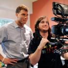 Blake Griffin watches a take on the camera monitor during the first day of his internship with comedy website Funny Or Die during the NBA lockout.