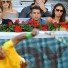 Cristiano Ronaldo and girlfriend, model Irina Shayk, watch Rafael Nadal serve during a tennis match on day nine of the Mutua Madrilena Madrid Open.