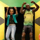 Bolt models a Jamaica Olympic kit with designer Cedella Marley, daughter of Bob Marley, during the kit unveiling in London.