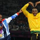 Bolt has fun with Great Britain's 5000-meter gold medalist Mohamed Farah during the London Olympic Games.