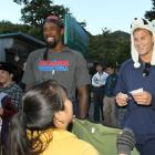 DeAndre Jordan and Blake Griffin bargain with vendors during a visit to the Great Wall of China. Hope they didn't pay full price for those hats.