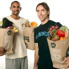 "Phoenix Suns teammates Nash and Grant Hill pose with some groceries during this SI shoot, prior to each player's last season with the team. Hill would join the Clippers for his final season, while Nash would sign with the Lakers, after which HIll said in regards to Nash, ""That's like transferring from Duke and going to Carolina."""