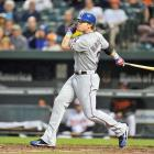 Hamilton went 5-for-5 with four home runs and a double, recording a career-high eight RBI and an American League record 18 total bases in the Texas Rangers' 10-3 win over the Baltimore Orioles.