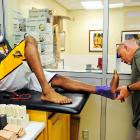 Bryant has his ankle wrapped in the locker room before a playoff game against Denver in 2012.