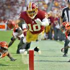 Redskins quarterback Robert Griffin III stepped out of bounds before making a dive towards the end zone against the Bengals.