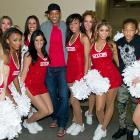 Will Smith and Jaden Smith pose with the Sixers Dancers during the 76ers-Nets game at the Wells Fargo Center in Philadelphia.