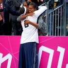 LeBron greets First Lady Michelle Obama at the London Olympics.