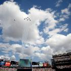 The U.S. Air Force aerial demonstration team of Thunderbirds perform a flyover before the New York Yankees-Boston Red Sox game at Yankee Stadium in 2012.